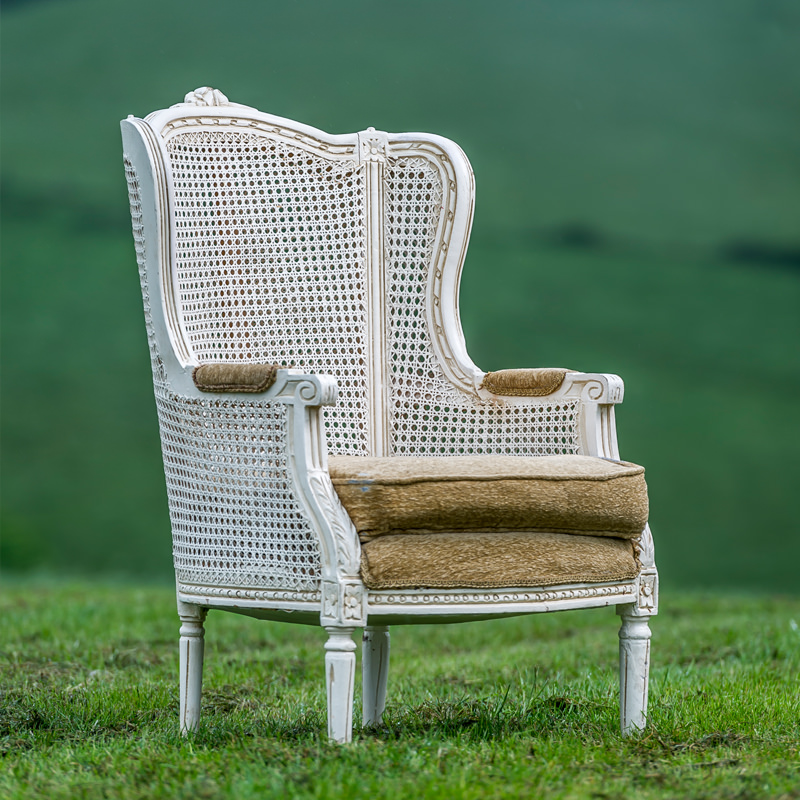 white wicker armchair the prop factory sustainable prop hire for