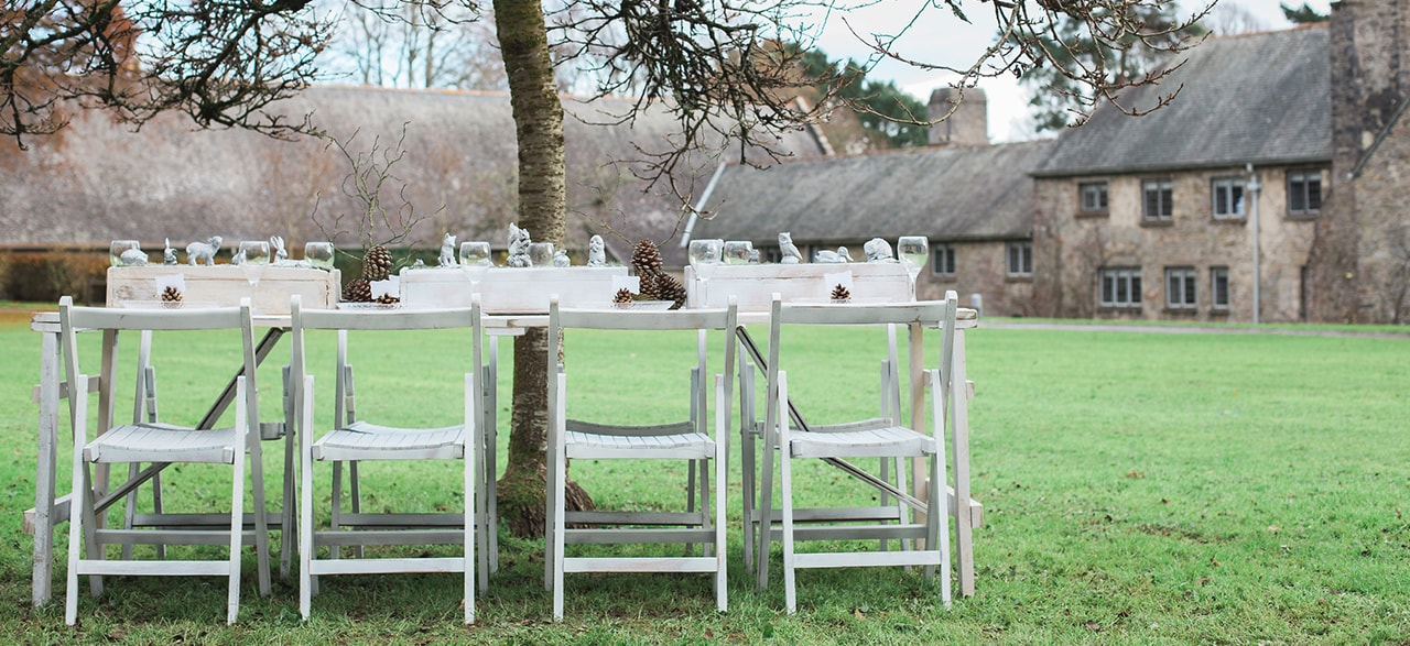 White Folding Chairs and Farmhouse White Table